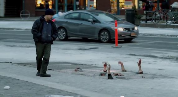 camera-cachee-pub-nouvelle-saison-serie-the-walking-dead-new-york-zombies-sous-grilles-3